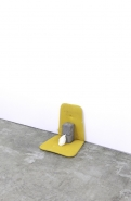 David Kefford, Deflated 2012. Concrete blocks, balloon, chair seat cover, 40 x 40 x 38 cm