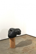 David Kefford, One Night Stand 2012. Sports bag, concrete, wax, wooden stand, 23 x 55 x 65 cm