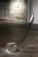 David Kefford, Chain Reaction 2012. Lampshade, concrete, rubber tubes, wax, plastic bottle, papier mache, tape, wool, chain, string, talcum powder, paint, Vaseline, 60 x 303 x 231 cm